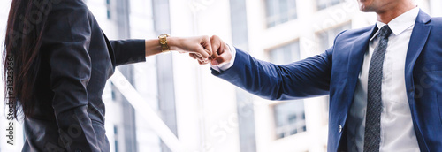 Fotografiet Businessman and partner giving fist bump hand