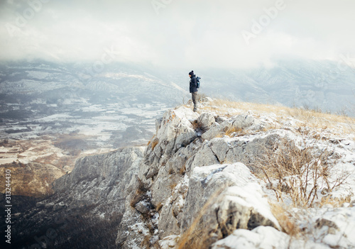 Obraz Hiker standing at mountain viewpoint, travel lifestyle hiking wanderlust concept - fototapety do salonu