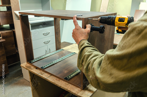 Obraz Assembly of hard furniture, close-up drawers for drawers - fototapety do salonu