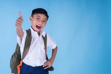 An Ecstatic Asian School Boy W...