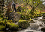 Old mill with a waterwheel built in the early 1800's in Borrowdale in the Lake District, Uk