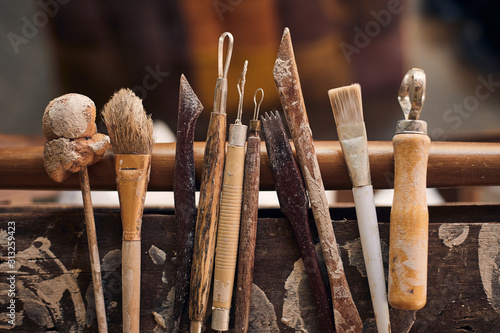 Tools for forming clay on  wooden background.. Fototapete
