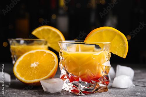 Cuadros en Lienzo  Fresh alcoholic Tequila Sunrise cocktail on grey table