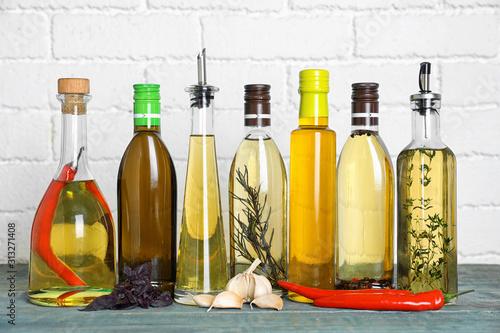 Fototapeta Different cooking oils on blue wooden table obraz
