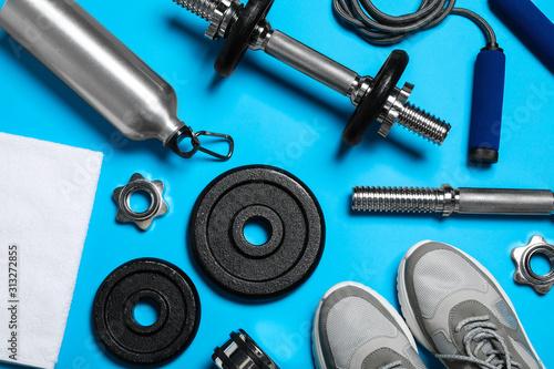 Fototapeta Gym equipment on light blue background, flat lay obraz na płótnie