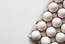 Detail Of White Chicken Eggs In Paper Tray.