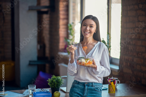 Fototapeta Nice good looking woman standing with her salad obraz