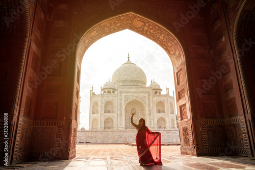 Indian woman in red saree/sari in the Taj Mahal, Agra, India