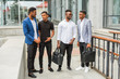 four young african men near the building in summer