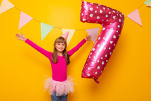 Birthday Girl Throwing A Giant Balloon