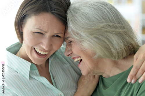 Stampa su Tela Close up portrait of senior woman with daughter at home