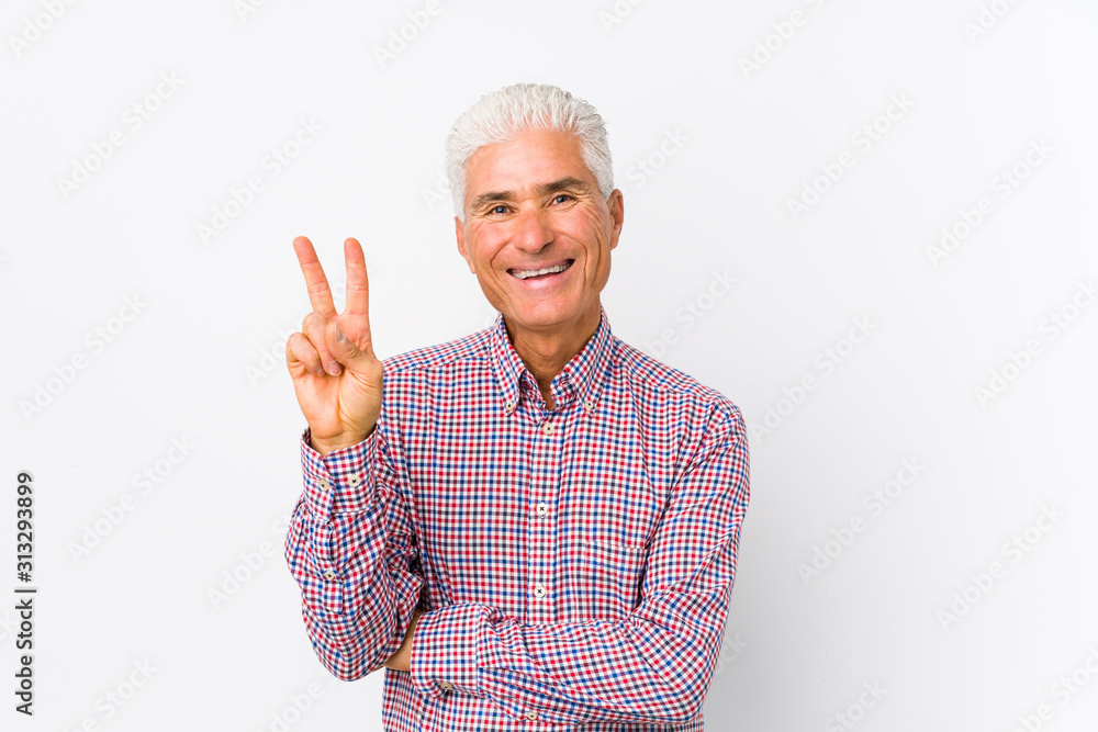 Fototapeta Senior caucasian man isolated showing number two with fingers.