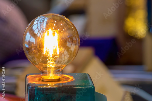 Edison lamp with a little shining electrical angel inside the bulb Fototapet
