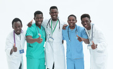 Smiling Interns Doctors Giving...