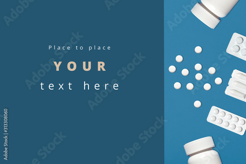 Photo Shot of jars of pills, medicines, tablets isoalted over blue background
