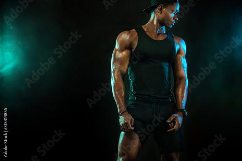 Sports men athlete on dark background Canvas Print