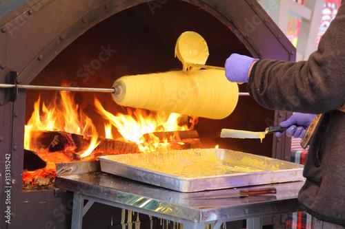 Vászonkép Sakotis or raguolis,  branchy pastry, cooked on open fire