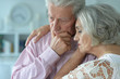 canvas print picture Close up portrait of unhappy senior couple posing at home