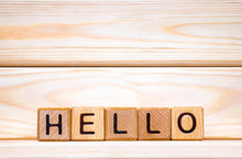 Hello Word Made Of Wood Background. Greeting Concept. Hello Sign Wriiten On Cubes. Invitation To World. Word Hello Written With Wooden Cubes. Hello Background. Welcome, Salute Idea