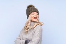 Young Teenager Girl With Winter Hat Over Isolated Blue Background Laughing