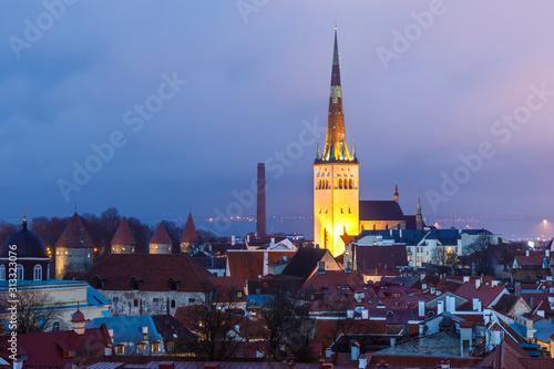 Photo  Illuminated church St. Olaf in Tallinn at night