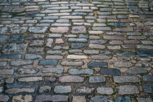 Abstract Background Of Old Cobblestone Pavement Or Brick Floor Close-up.