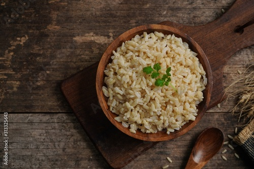 Fotografiet Bowl of cooked Whole grain brown rice  on wooden background overhead view