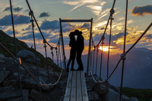 Silhouette Of Kissing Couple D...