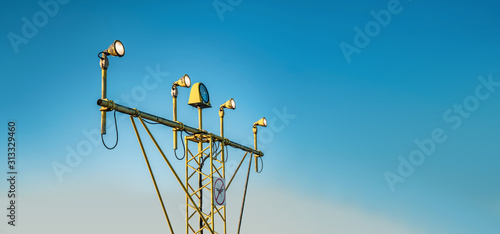 Drone zone sign on approach lighting system at runway Wallpaper Mural