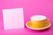 canvas print picture - yellow cup on a pink  background