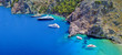 Leinwanddruck Bild - Aerial drone ultra wide photo of tropical exotic islet with turquoise clear open ocean sea