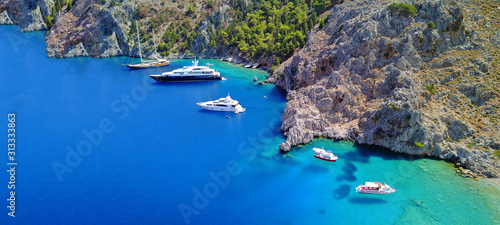 Aerial drone ultra wide photo of tropical exotic islet with turquoise clear o...