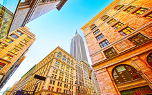 Bottom Up Street View On Financial District Of Lower Manhattan, New York City, NYC, USA. Skyscrapers Tall Glass Buildings United States Of America. Blue Sky On Background. Empty Place For Copy Space.