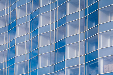 Beautiful architectural structures. Buildings of glass Windows. Background of glass Windows