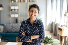 Smiling Indian Woman Looking At Camera Posing At Modern Home