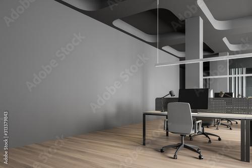 Fototapeta Workplace in modern gray open space office obraz