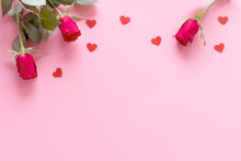 Valentines Day Flat Lay: Red Roses And Hearts On A Pink Background With Copy Space