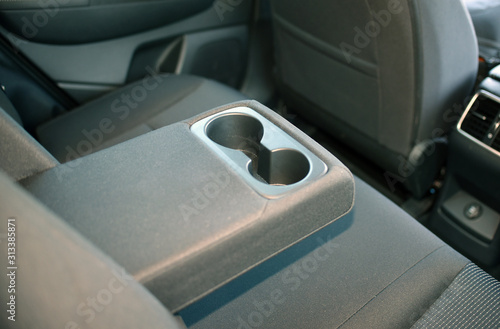 Photo armrest in the car with cup holder for rear seats row