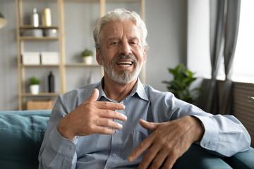 Mature man having conversation using webcamera online application