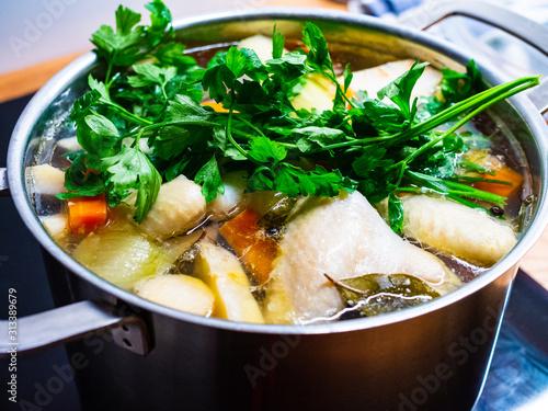 Fototapeta Broth - boiling chicken soup in pot  obraz