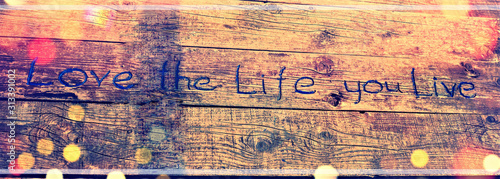 Positive inspiring quote written carved  in wood Love the life you live Fototapet