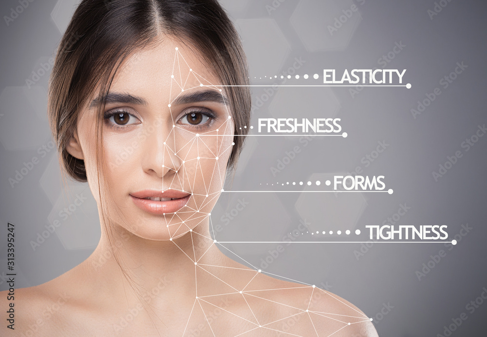 Fototapeta Young pretty lady with skin featers marks over grey background