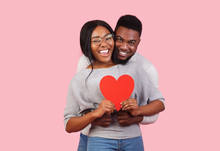 Joyful African Couple Holding Big Red Heart Together