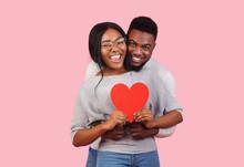 Joyful African Couple Holding ...