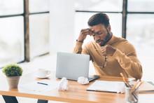 Frustrated Black Businessman Taking Off Glasses Massaging Nose