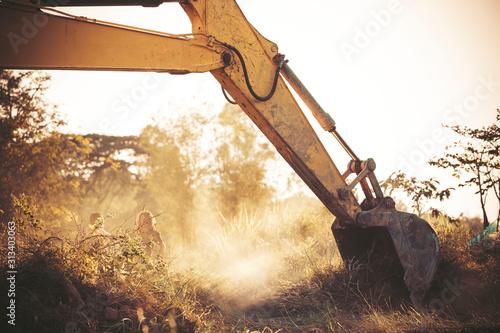 excavator is working during sunset, construction site digger,Loader backhoe Canvas Print