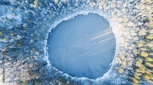 Obraz Ice on the lake. A frozen lake.  Ice on the water's surface. Winter season. - fototapety do salonu