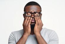 Afro Guy In Glasses Rubbing Hi...