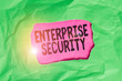 canvas print picture - Word writing text Enterprise Security. Business photo showcasing decreasing the risk of unauthorized access to data Green crumpled ripped colored paper sheet centre torn colorful background