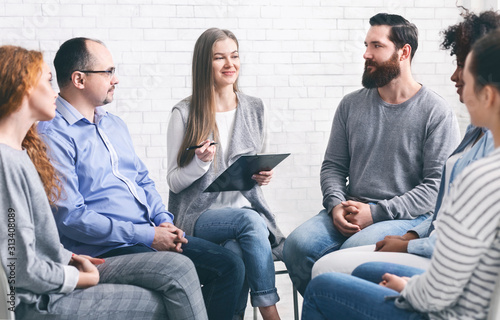 Psychotherapist talking to addicted patients in office Canvas Print